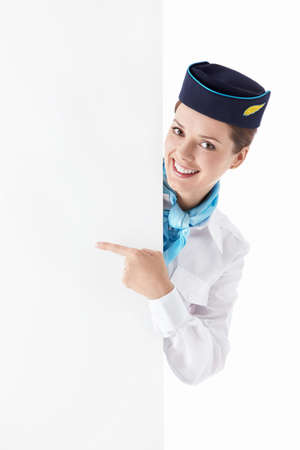 Stewardess in uniform with a billboard on a white background Stock Photo - 12928712
