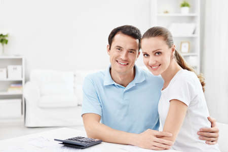 An attractive young couple at home photo