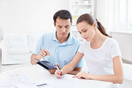 finance girl: Young couple calculates Finance Stock Photo