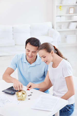 Young couple calculates Finance at home photo