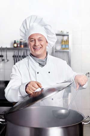 chefs whites: Chef cooks in the kitchen