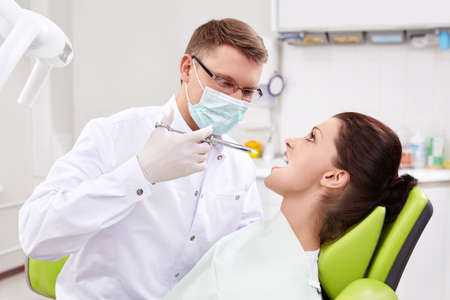 The dentist makes an injection at the clinic photo