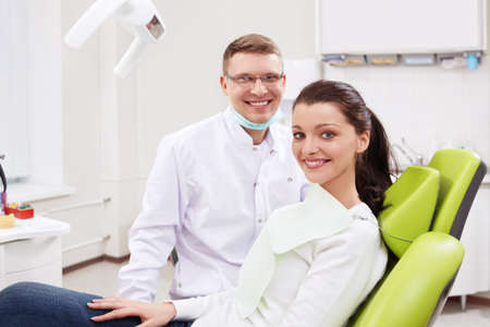 male dentist: Patient on reception at the dentist