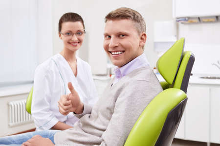 The dentist and the patient in the clinic photo