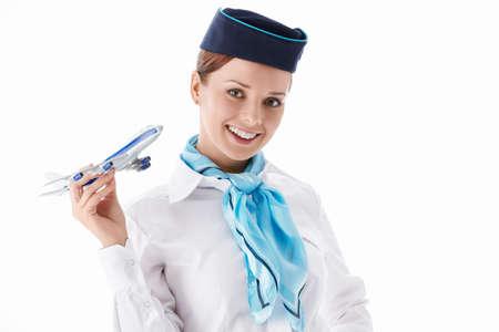 Un asistente de vuelo atractiva sobre un fondo blanco Foto de archivo - 13131800
