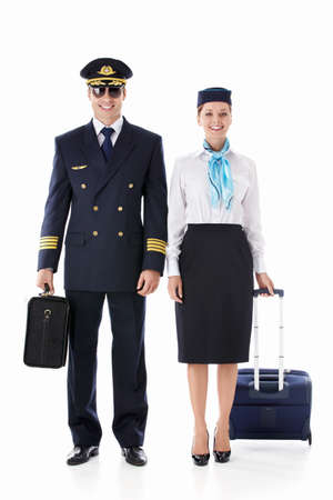 havayolu: The pilot and flight attendant with a suitcase on a white background Stok Fotoğraf