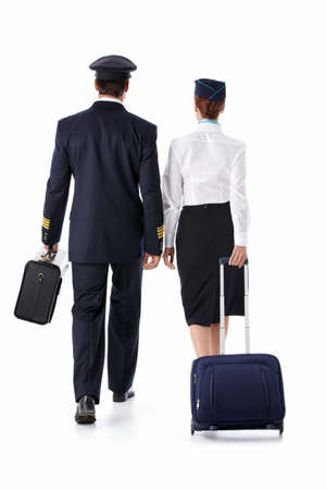 stewardess: The pilot and flight attendant with a suitcase isolated