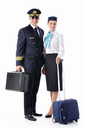 stewardess: The pilot and flight attendant with a suitcase on a white background Stock Photo