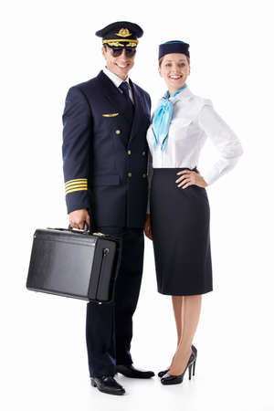 The pilot and flight attendant with a suitcase on a white background photo