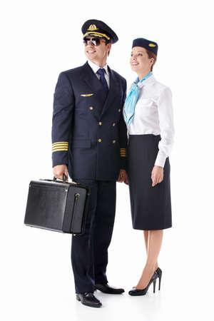 pilotos aviadores: El asistente de vuelo del piloto y con una maleta aislados