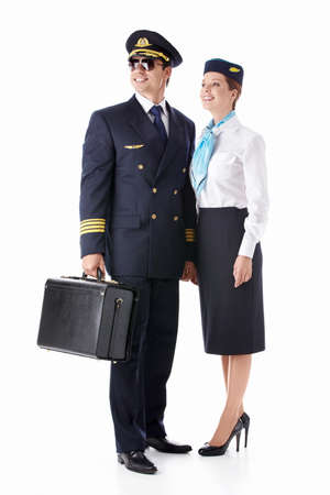 The pilot and flight attendant with a suitcase isolated photo