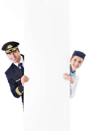 El asistente de vuelo del piloto y con un cartel Foto de archivo - 13131798