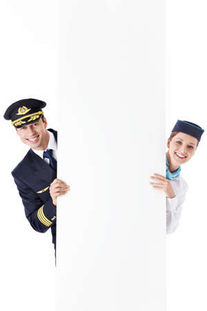 The pilot and flight attendant with a billboard photo