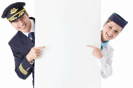 airline: The pilot and flight attendant with a billboard