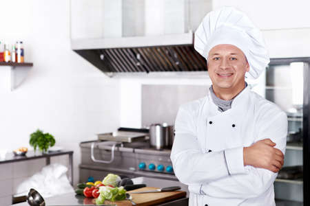 chefs whites: Mature cook in the kitchen