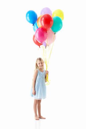 helium balloon: Little girl with balloons isolated Stock Photo