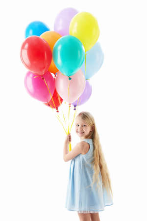 Little girl with balloons on a white background photo