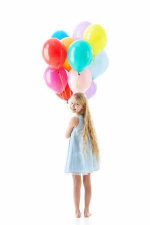 little girl barefoot: Little girl with balloons isolated Stock Photo