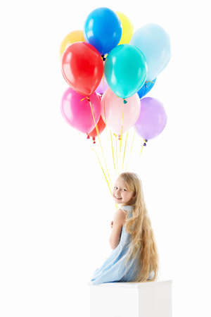 Girl with balloons isolated photo