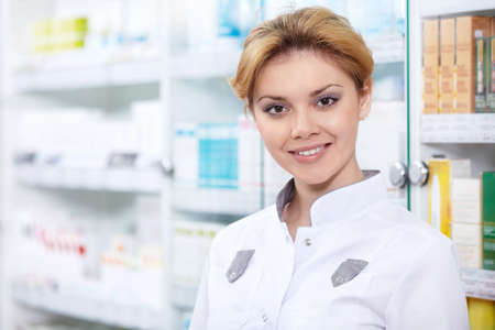 A young pharmacist at the pharmacy Stock Photo - 13496792