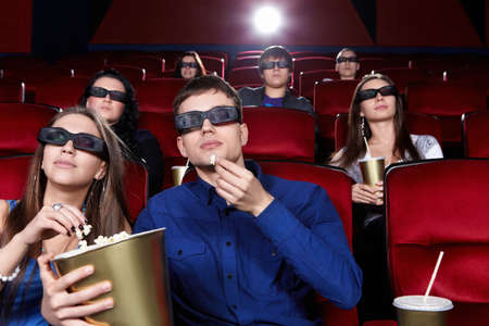 Young people in the cinema in 3D glasses photo