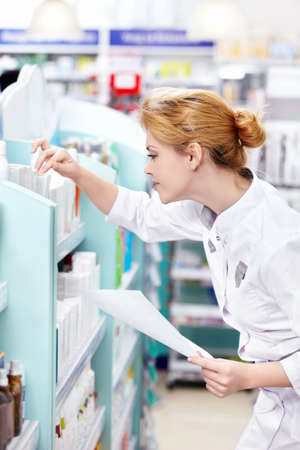 A young pharmacist at the pharmacy photo