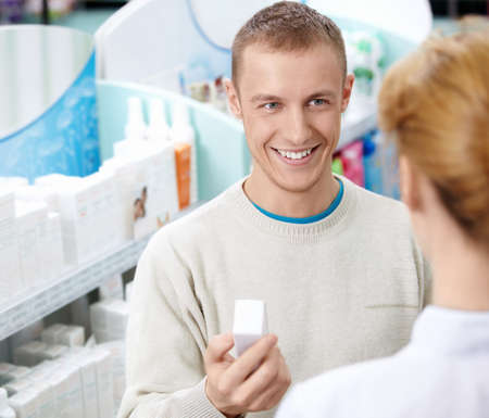 The pharmacist and the customer at the pharmacy Stock Photo - 13496518