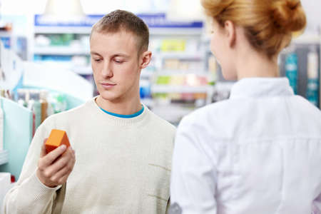 The pharmacist and the customer at the pharmacy Stock Photo - 13496794
