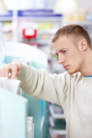A young customer in the pharmacy Stock Photo - 13496808