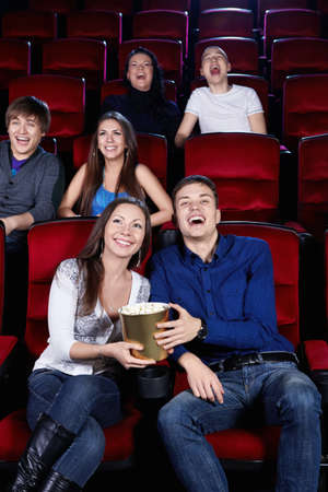 Young people in the cinema photo