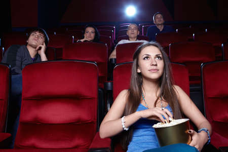 A young girl at the cinema photo