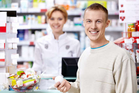 pharmacist: The pharmacist and the customer at the counter Stock Photo