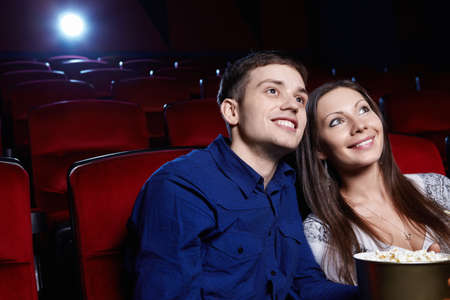 A couple in a movie theater photo