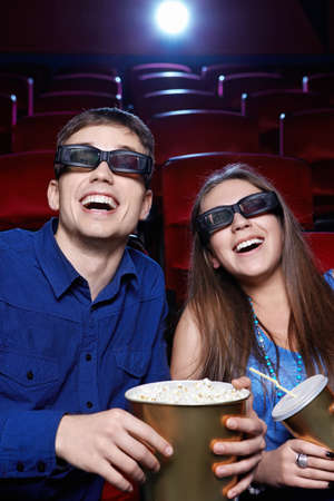 Young couple in a movie theater photo