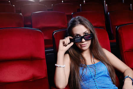 A young girl at the cinema Stock Photo - 13497042