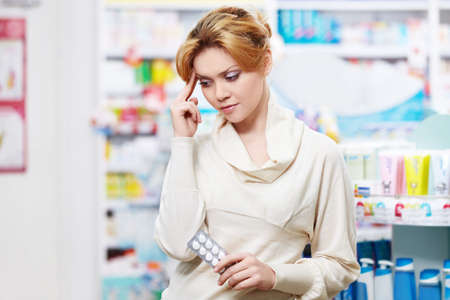 The pharmacist at the pharmacy of pills photo