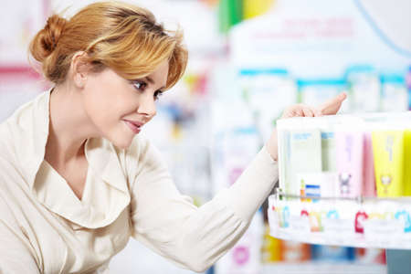 The buyer at the pharmacy photo