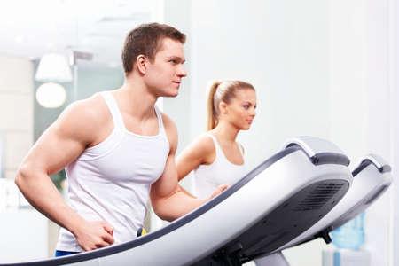 treadmill: Young people on treadmills