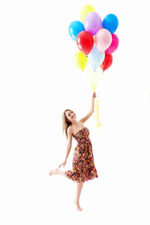 Young girl with balloons on a white background photo