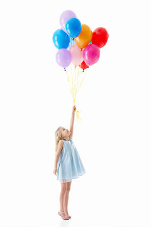 kids dress: Little girl with balloons on a white background Stock Photo
