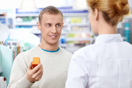 A young man at the pharmacy photo