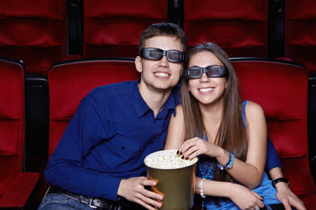 Smiling couple in the cinema photo