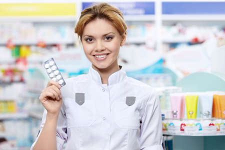 The pharmacist at the pharmacy with tablets photo