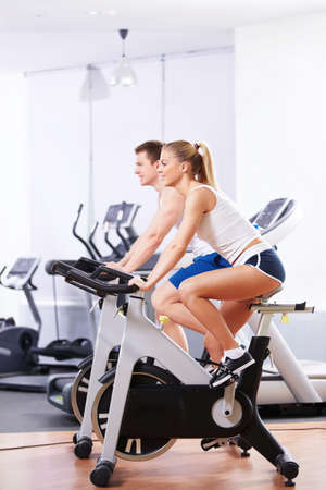 Young people on bikes in a fitness club Stock Photo - 13709691