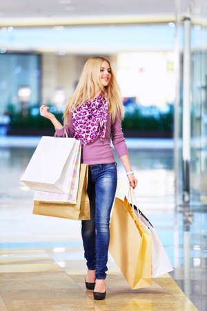 Woman with shopping bags in store photo