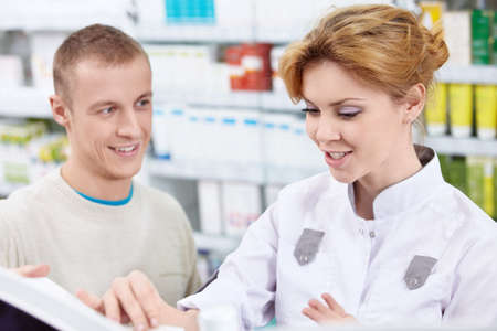 Pharmacist to the patient at the pharmacy photo