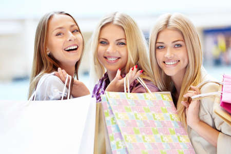 Beautiful girls with shopping bags in shop Stock Photo - 13936933