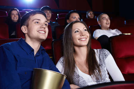 watching movie: Smiling people in the cinema