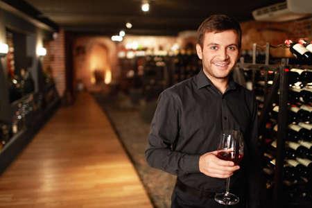 Attractive man in the wine cellar photo