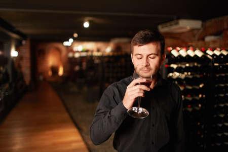 degustation: Attractive man tastes wine Stock Photo